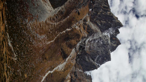 Vertical shot of Time-lapse of rocky Himalayan peaks and passing clouds Footage