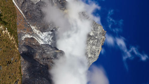 Vertical shot of Time-lapse of clouds swirling around a Himalayan peak Footage