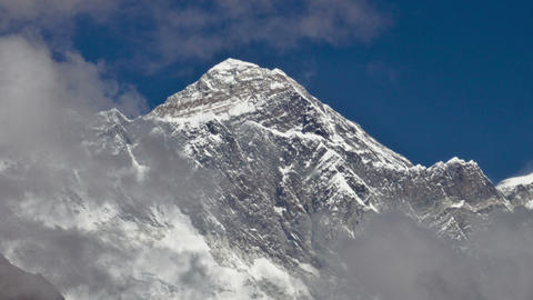 Panning shot of Time-lapse of clouds swirling around Mount Everest Footage