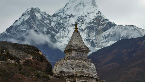 Time-lapse of a buddhist stupa with Ama Dablam peak in the background. Cropped Footage