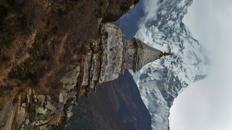 Vertical shot of Time-lapse of a buddhist stupa with Ama Dablam peak in the back Footage