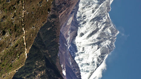 Vertical shot of Time-lapse of Everest and surrounding peaks and people on a for Footage