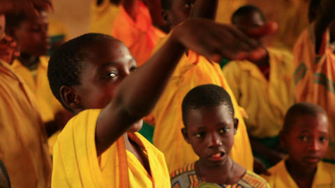 Close up of a boy raising his hand in a classroom in Kenya Footage