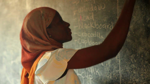Close up of a schoolteacher in a full classroom in Kenya Footage