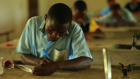 School boy doing chemistry in Kenya Footage