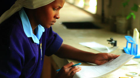 Close up of a girl doing chemistry in Kenya Footage