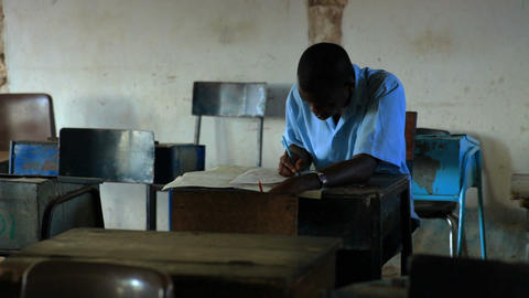 Students taking an exam in class in a school in a village in Kenya Footage