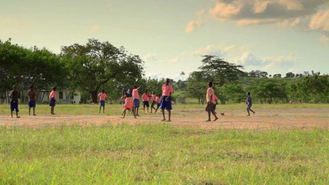 Boys playing during recess near a Kenyan village Live Action