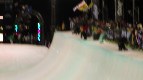 Snowboarder in a half-pipe competition Footage