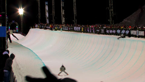 Snowboarder in a half-pipe at a competition Footage