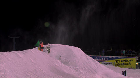 Jumping snowmobiles in a competition Footage