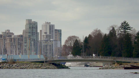 Pedestrian bridge blocks entrance to Vancouver harbor filled with boats Footage