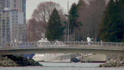 Medium shot of bridge blocking entrance to Vancouver harbor filled with boats Footage