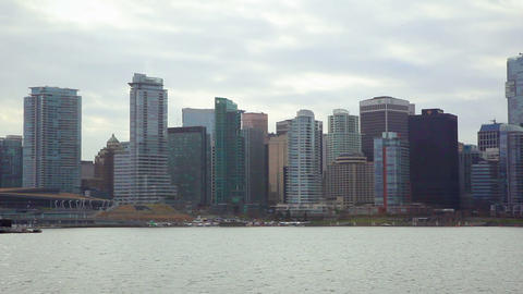 Long shot of Vancouver skyline from across harbor Live Action