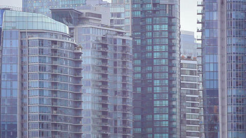 Panning close-up of Vancouver skyline from across water Footage
