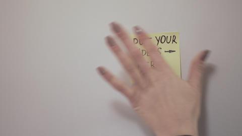 Closeup Woman`s Hand Stick Paper On Flip Chart Footage