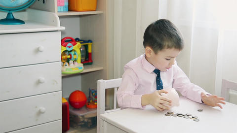 The little boy counts the accumulated money in the piggy Bank 1080 HD Footage