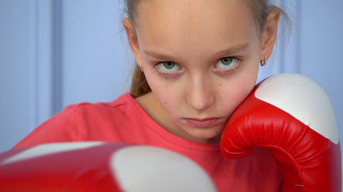 Close up sporty young girl doing boxing exercises, making direct hit. Young girl Footage