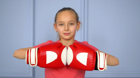Portrait young girl boxer in boxing gloves ready to fighting on ring close u Footage