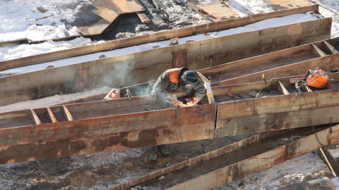 Welder at work on a construction site Footage