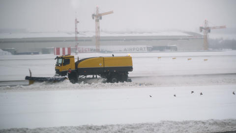 Snowblower clears the airport runways. Prague, 04 february 2019 Footage