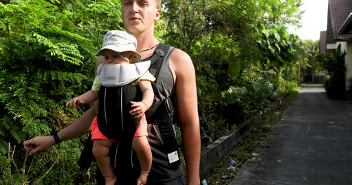 Crop man with baby in carrier Footage