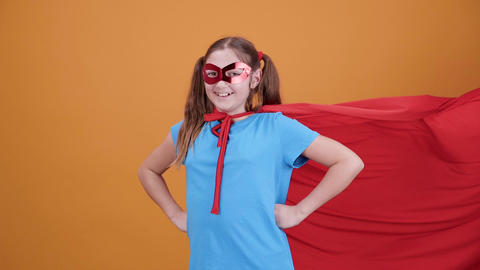 Very positive girl disguised in a movie superhero smiling at the camera Footage