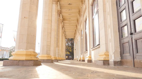 Old columns on a background of beautiful sun rays. Ukraine. Kiev. 07.11.18 Park Footage