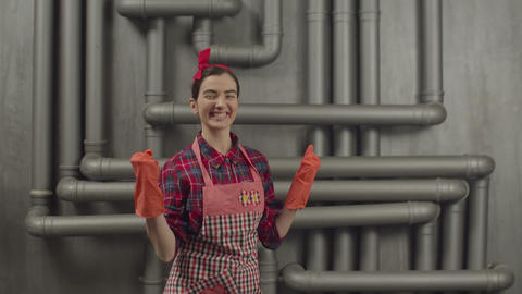 Happy expressive housewife doing winner gesture Live Action