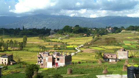 Farm landscape with patches of homes in Nepal Footage