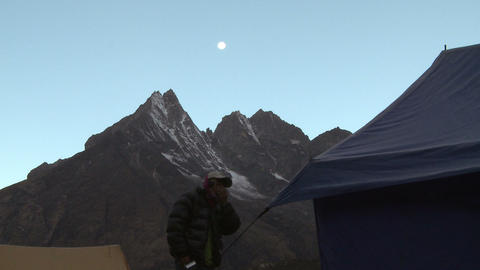 Man near a group of tents in the morning in the Himalayas Footage