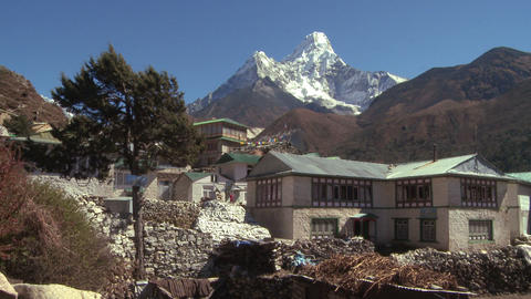 Buildings with flags and trees near Ama Dablam Footage
