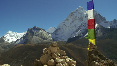 Colorful buddhist prayer flags on a pole in the Himalayas Footage