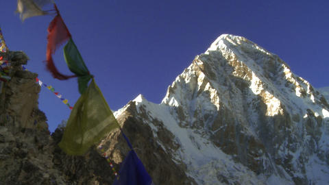 Buddhist prayer flags on a ridge with Everest in the background Footage