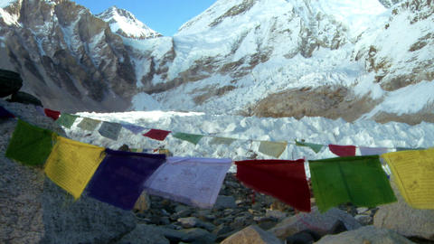 Mount Everest with Buddhist prayer flags in the foreground Footage