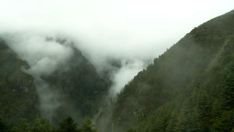 Mountains shrouded in mist and clouds Footage