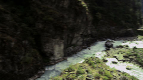 River gorge in Nepal with a bridge spanning the gorge Footage