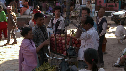Man weighing merchandise in a marketplace in Nepal Footage