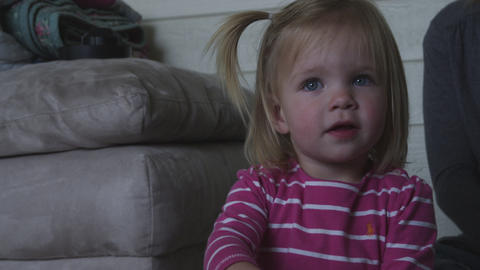Handheld shot of a blonde little girl with a ponytail Footage