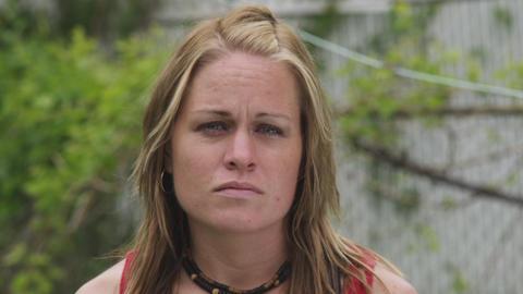 Close-up handheld shot of a sad caucasian woman Live Action