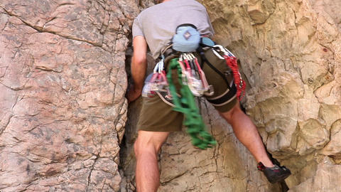 Tilt shot of of a blond male rock-climber Footage