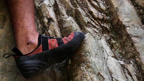 Closeup of a man's rock-climbing shoes Live Action