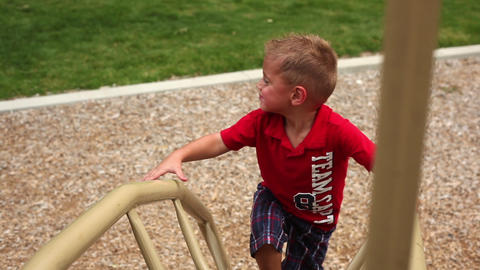 Handheld shot of a little boy at a playground Footage