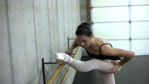 Tracking shof of a dancer exercising on a ballet barre Footage