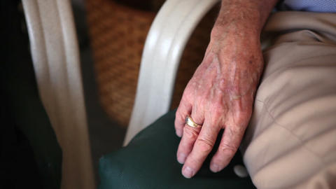 A close up shot of an elderly man's wedding ring on his right hand Footage
