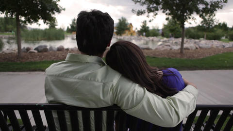 A shot of a couple on a bench on a cloudy day Footage