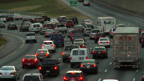 A static shot of traffic passing the 249C exit in Atlanta, Georgia Live Action