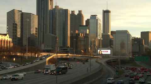 Tilting shot of the Atlanta Skyline down to freeway traffic Footage