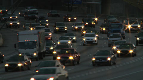Static shot of traffic on the freeway while the scene darkens in Atlanta, Georgi Footage
