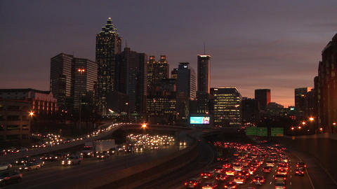 Static, wide shot of the Atlanta Skyline at night with traffic flowing below Footage